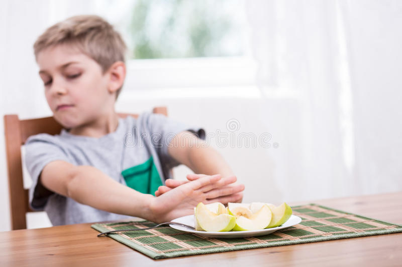 Refusing to eat healthy food stock photo