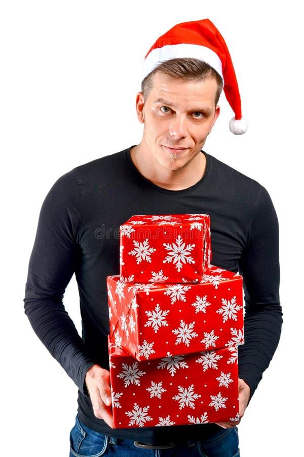 Regali di Natale della tenuta dell'uomo fotografia stock libera da diritti