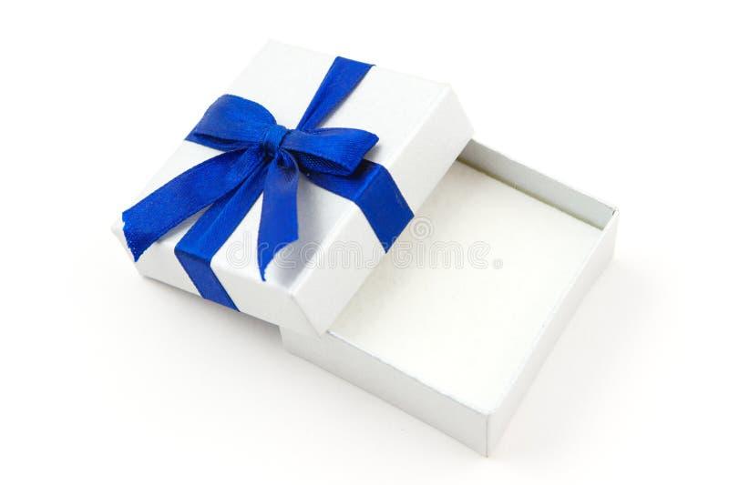 Regalo abierto con el arqueamiento azul imagen de archivo libre de regalías
