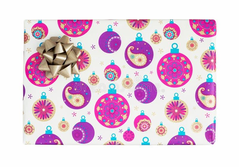 Regalo brillante de la Navidad con la cinta envuelta en un papel colorido imagen de archivo libre de regalías