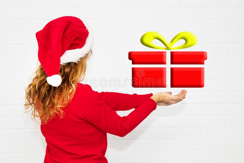 Regalo de la Navidad de la mujer foto de archivo libre de regalías
