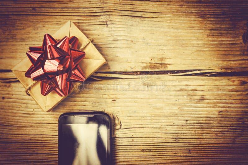 Regalo de la orden y de la entrega en el interno, la Navidad, Año Nuevo, Birthda foto de archivo