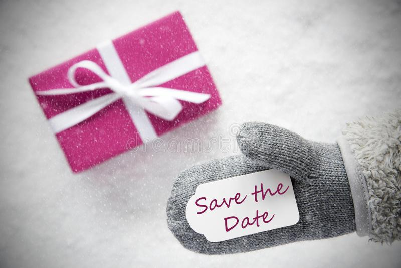 Regalo rosado, guante, reserva del texto la fecha, copos de nieve imagenes de archivo