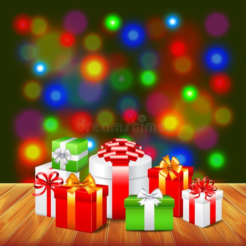 Regalos de la Navidad en fondo colorido de la tabla de madera libre illustration