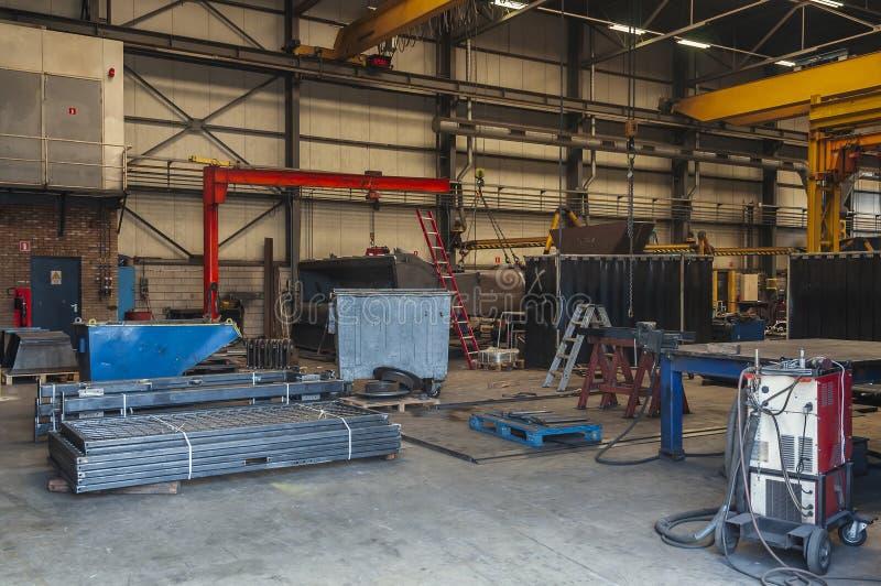Regardez à l'intérieur d'une entreprise de construction néerlandaise de machine photographie stock libre de droits
