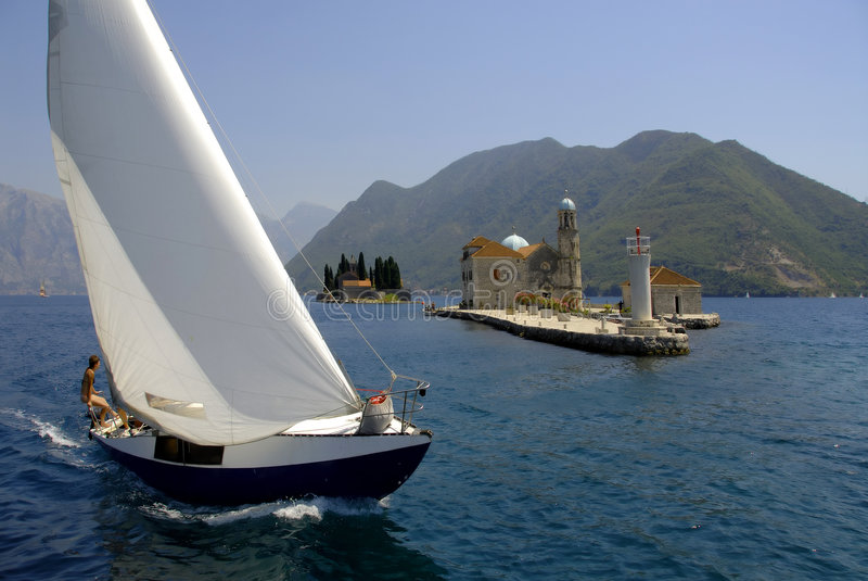 Regatta boat in Kotor Bay royalty free stock photo