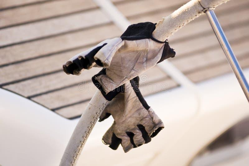Gloves on boat wheel. In regatta of Barcolana, Italy stock photos
