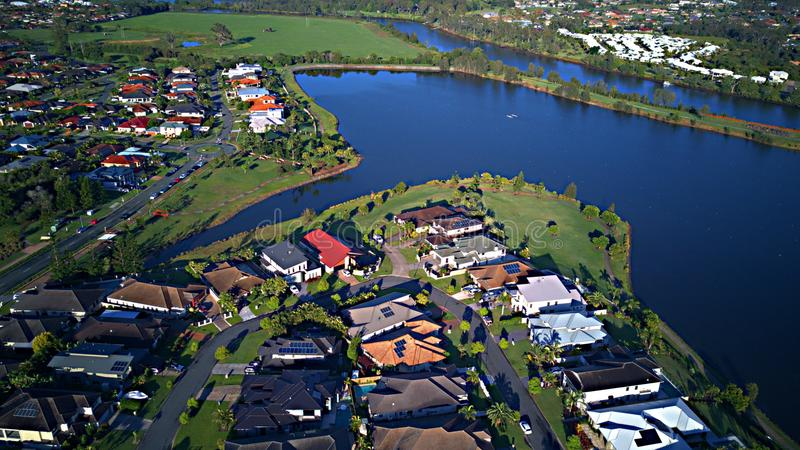 Regatta Waters On The lake and Parkland Gold Coast Grass play area House Estate next to Coomera River On The lake,. Coomera River Hope Island Parkland Gold Coast stock images