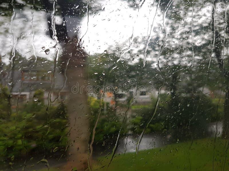 Regen behandeld venster royalty-vrije stock afbeelding
