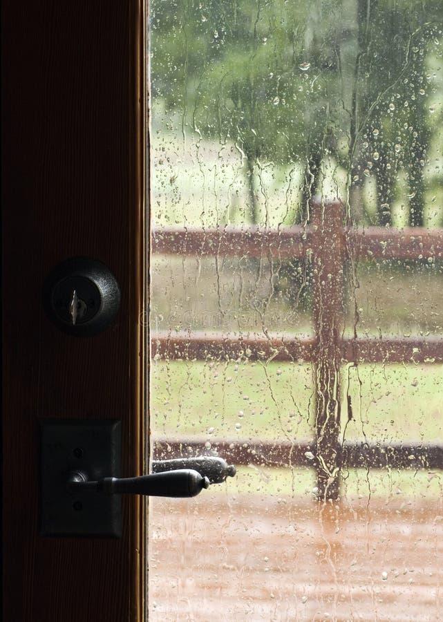 Regen door het Venster van de Deur royalty-vrije stock foto