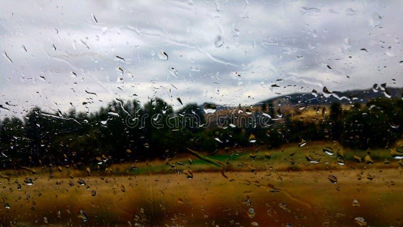 Regen und Reise stockbilder