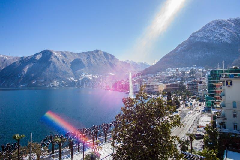 Regenboog in de grote stad van Lugano Ticino stock afbeeldingen