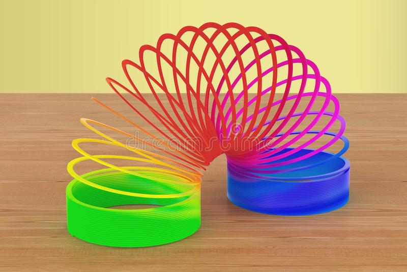 Regenboog gekleurd plastic, stiekem stuk speelgoed op de houten lijst 3d trek uit stock illustratie