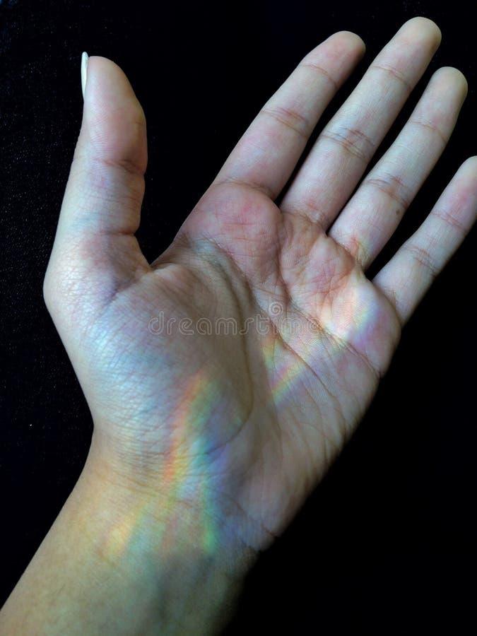 Regenboog in mijn hand royalty-vrije stock fotografie