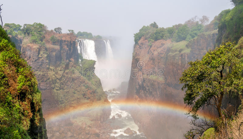 Regenboog in Victoria Falls stock afbeeldingen