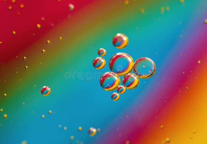 Regenboogbellen stock foto's