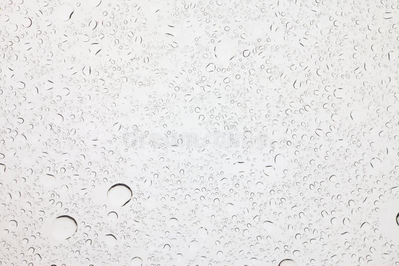Regendruppeltjes op glasachtergrond, Waterdalingen op glas royalty-vrije stock afbeelding