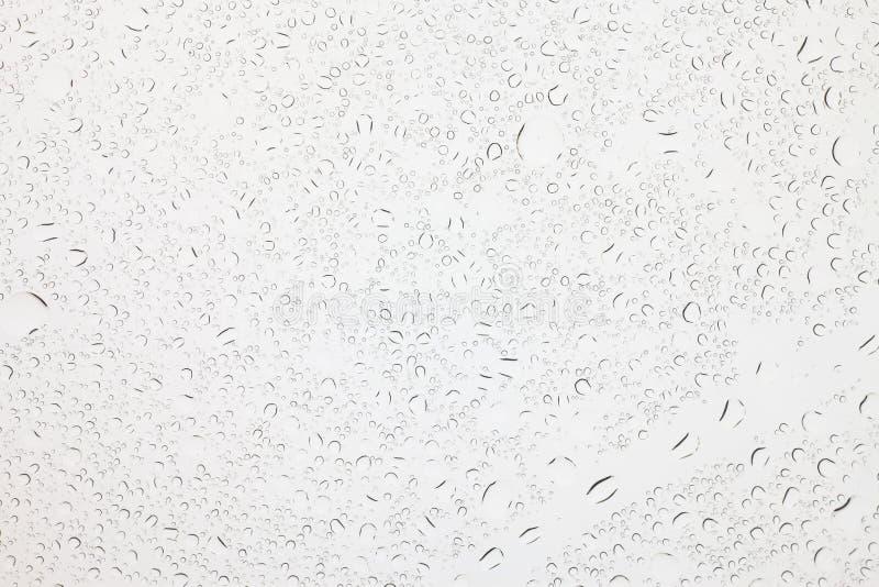 Regendruppeltjes op glasachtergrond, Waterdalingen op glas royalty-vrije stock fotografie