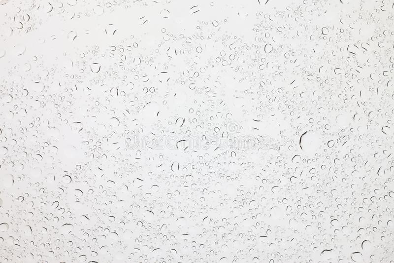 Regendruppeltjes op glasachtergrond, Waterdalingen op glas royalty-vrije stock afbeeldingen