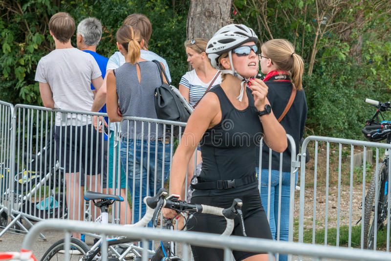 Regensburg, Bavaria, Germany, August 06, 2017, 28th Regensburg Triathlon 2017, Downswing of a bike racer in the transition area.  stock images