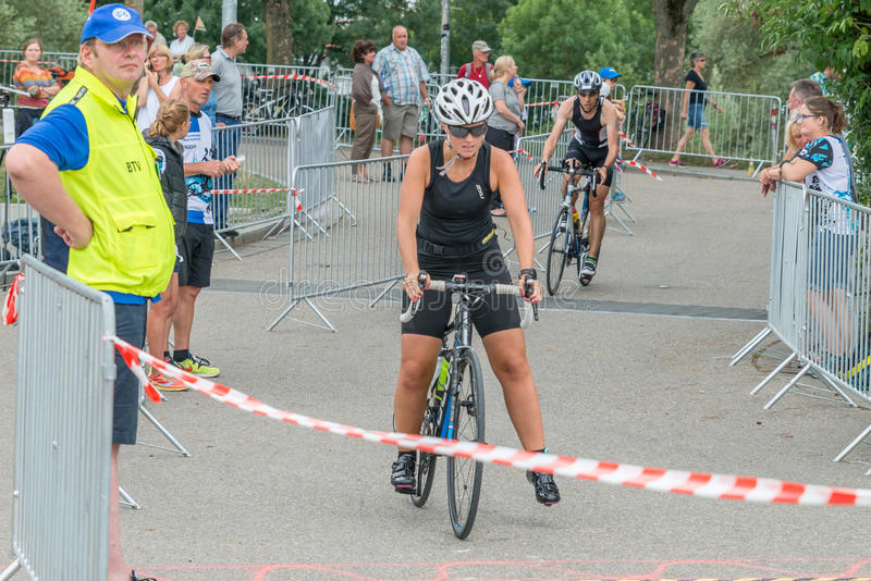 Regensburg, Bavaria, Germany, August 06, 2017, 28th Regensburg Triathlon 2017, Downswing of a bike racer in the transition area.  stock image