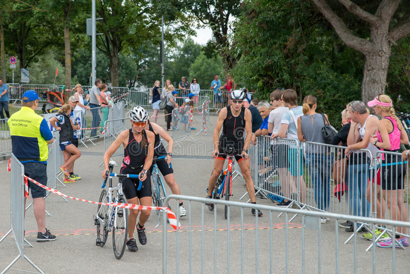 Regensburg, Bavaria, Germany, August 06, 2017, 28th Regensburg Triathlon 2017, Downswing of a bike racer in the transition area.  royalty free stock photo