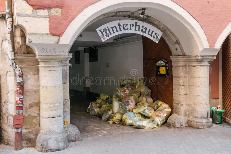 Regensburg, Bavaria, Germany, Mai 16, 2017, Heap of yellow dirt bags in the Entrance of the Hinterhaus in Regensburg.  stock image