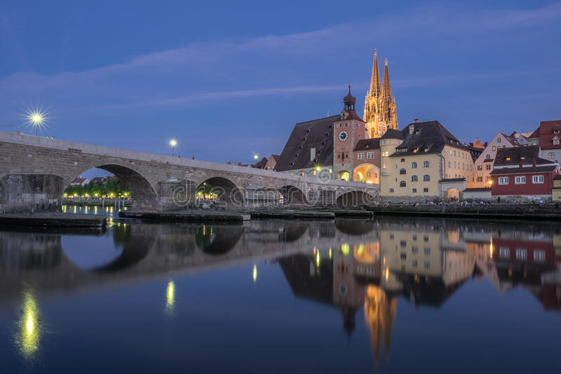 Regensburg cathedral and bridge stock photography