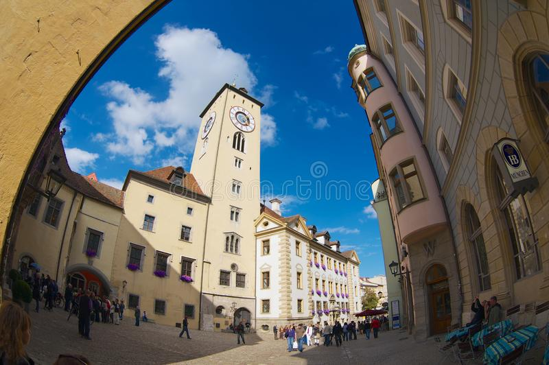 Tourists walk by the street of the historical part of Regensburg, Germany. royalty free stock photos