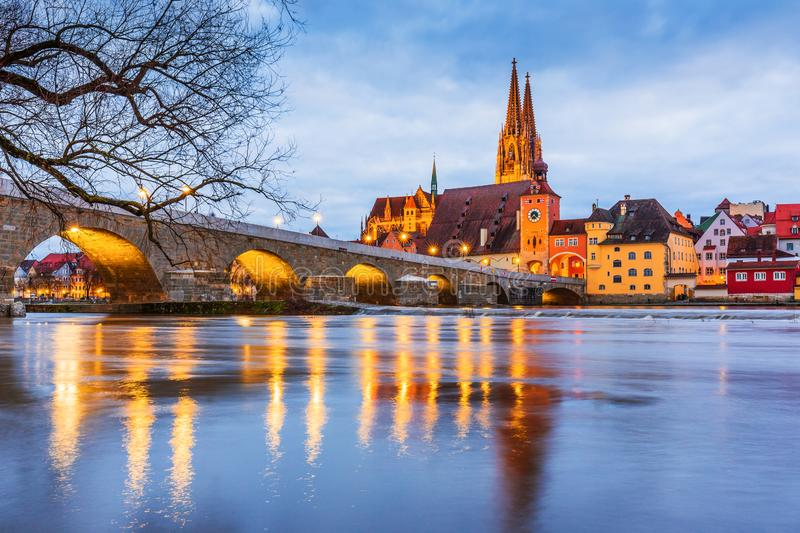 Regensburg, Germany. View from Danube on Regensburg Cathedral and Stone Bridge royalty free stock photos