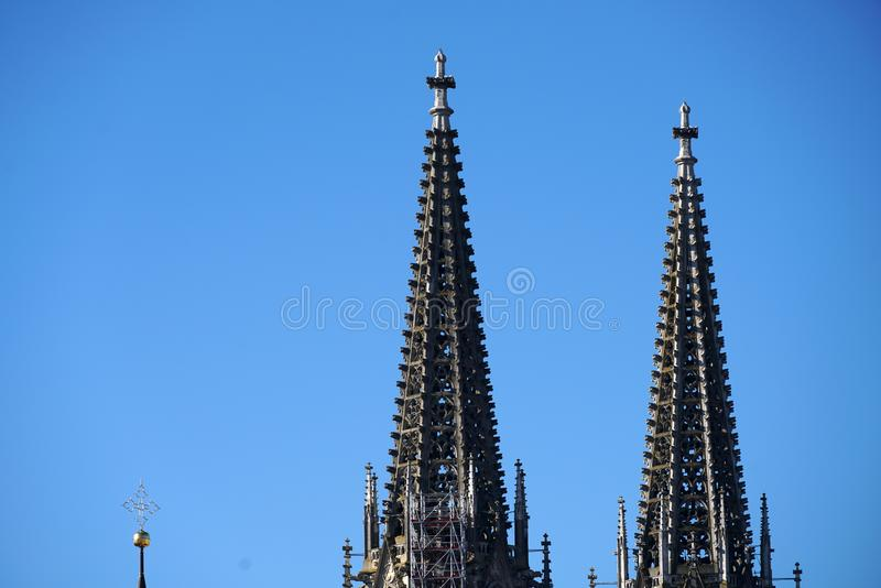 In Regensburg, old churches and St. Peter`s Cathedral. Photograph in the sunshine in the spring stock image