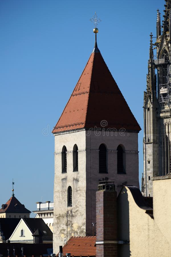 In Regensburg, old churches and St. Peter`s Cathedral. Photograph in the sunshine in the spring stock images
