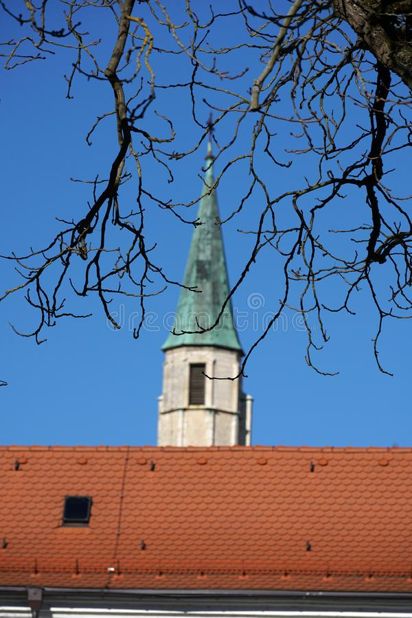 In Regensburg, old churches and St. Peter`s Cathedral. Photograph in the sunshine in the spring royalty free stock image