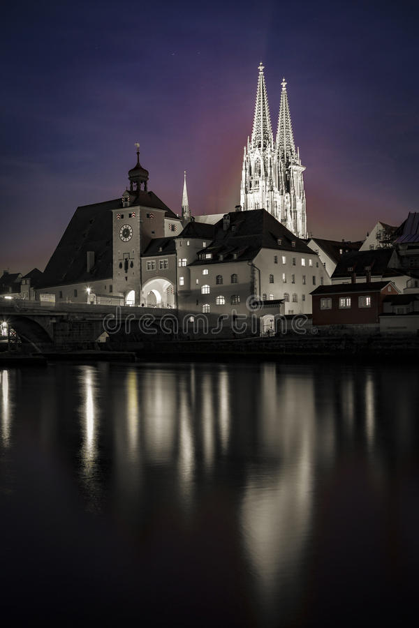 Regensburg St. Peters Church Nightview. Regensburg is a city in south-east Germany, situated at the confluence of the Danube, Naab and Regen rivers. With over stock images