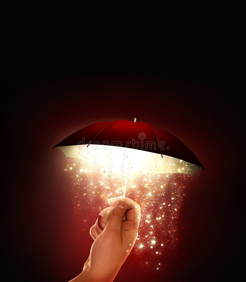 Regenschirm mit magischem Glühen stockfotos