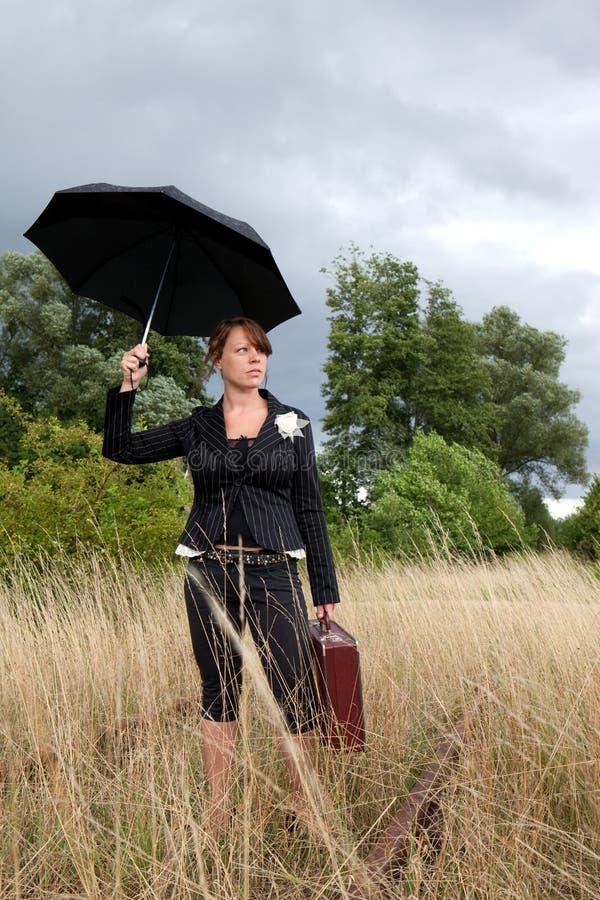 Regenschirmdame stockfoto