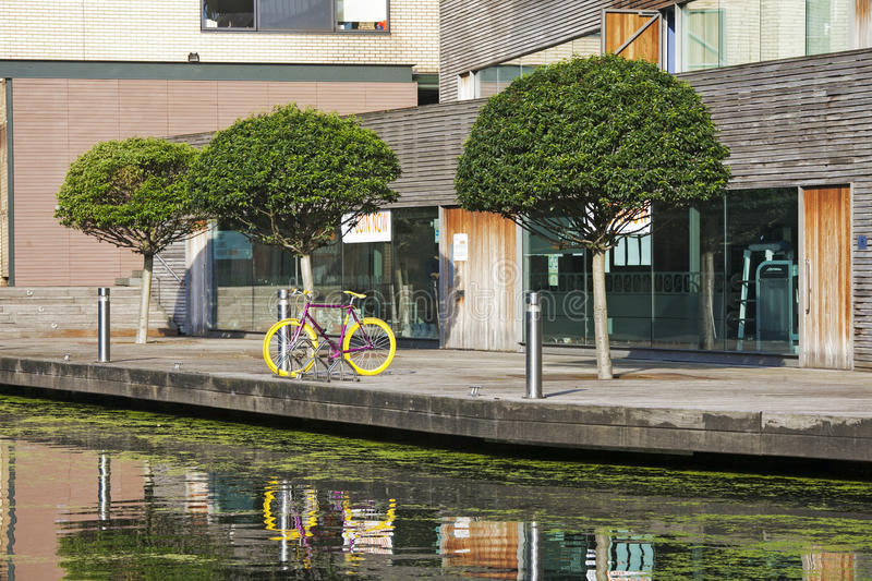 The Regent's Canal runs through an area of ongoing regeneration with new apartment buildings royalty free stock image