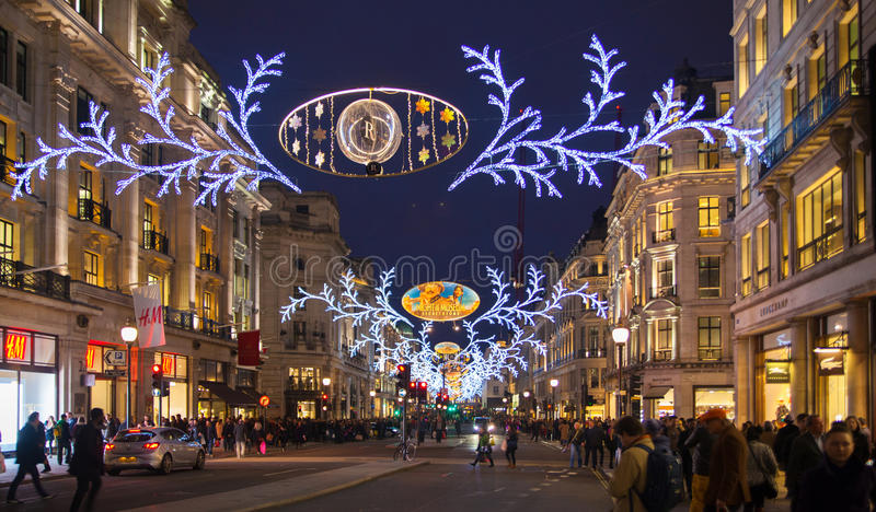 Regent street. London gets Christmas decoration. Streets beautifully lit up with lights, London. LONDON, UK - NOVEMBER 30, 2014: Regent street. London gets stock image
