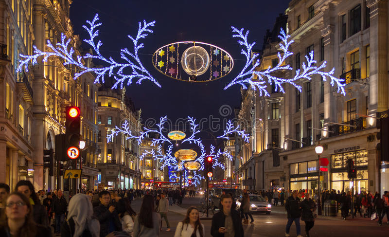 Regent street. London gets Christmas decoration. Streets beautifully lit up with lights, London. LONDON, UK - NOVEMBER 30, 2014: Regent street. London gets royalty free stock image