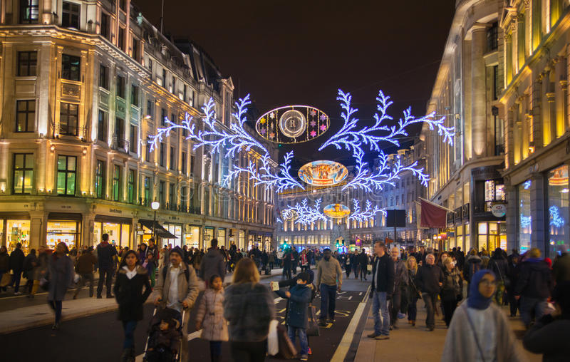 Regent street. London gets Christmas decoration. Streets beautifully lit up with lights, London. LONDON, UK - NOVEMBER 30, 2014: Regent street. London gets stock photography