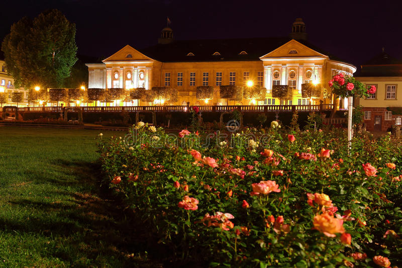 Baroque building with rose garden lighted at night. View from the rose garden to the Neo-Baroque building Regentenbau illuminated by night. A tourist attraction stock image