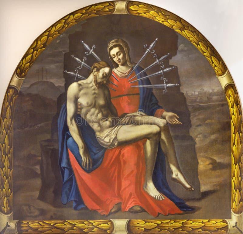 REGGIO EMILIA, ITALIEN - APRIL 12, 2018: Målningen av pietaen Madonna av sju sorger i kyrkliga Chiesa dör Cappuchini av okända royaltyfri foto