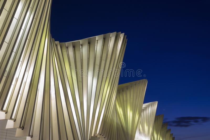 REGGIO EMILIA, ITALY - APRIL 13, 2018: The Reggio Emilia AV Mediopadana railway station at dusk by architect Santiago Calatrava.  stock photography