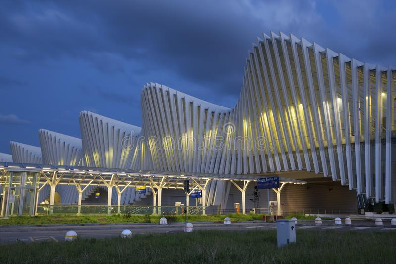 REGGIO EMILIA, ITALY - APRIL 13, 2018: The Reggio Emilia AV Mediopadana railway station at dusk by architect Santiago Calatrava.  royalty free stock image