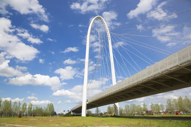 Reggio Emilia - Modern arched bridge by architect Santiago Calatrava.  royalty free stock photography