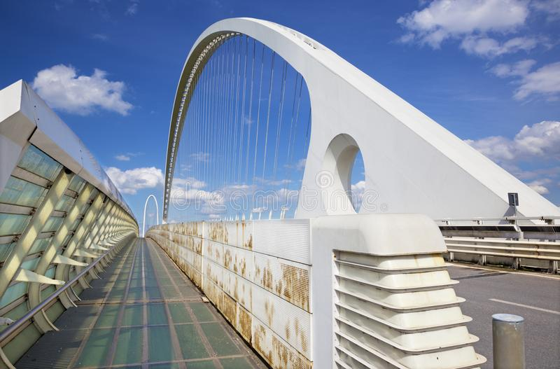 Reggio Emilia - Modern arched bridge by architect Santiago Calatrava. Reggio Emilia - Modern arched bridge by architect Santiago Calatrava royalty free stock photos
