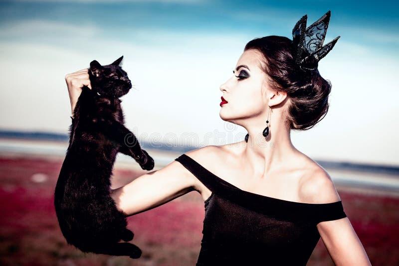 Regina e gatto immagini stock libere da diritti