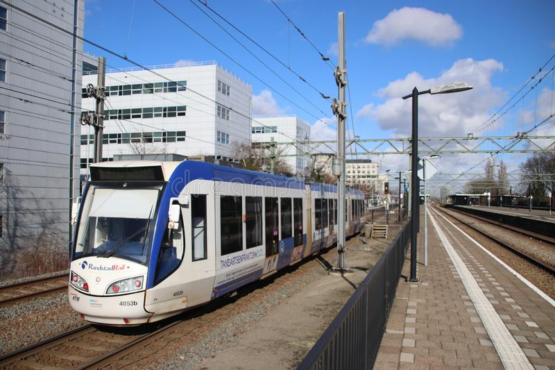 Regio Citads tram vehicle on the rails for Randstadrail in The Hague operated by HTM at station Den Haag Laan van Noi. royalty free stock image