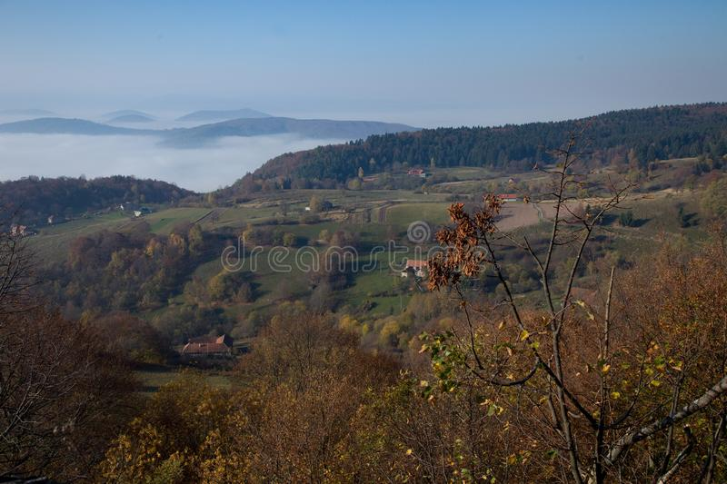 Region of Podpolanie. Above the city of Detva, Slovakia. Nature is colorful during autumn. In the valley is mist. On the horizon are mountains. This region is stock image