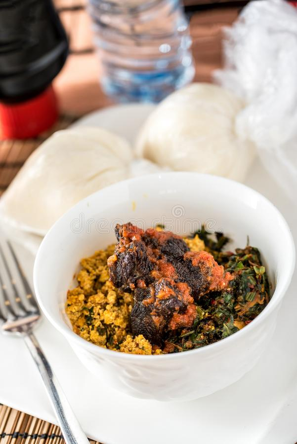 Regional African Food. On white plate on wooden background royalty free stock photography